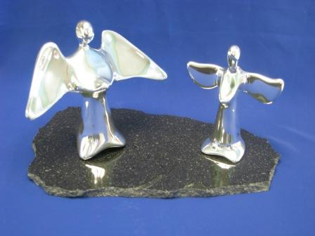 1962 and 1959 MV angels on dark marble base